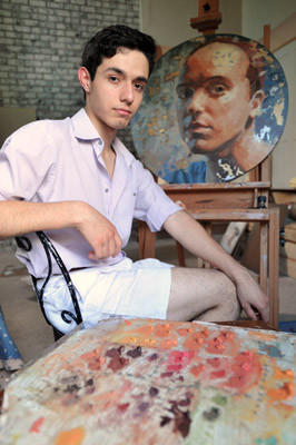 Arturo Cabrera, 18, of Nazareth will participate in Art in the Park for the first time this year.  He is in his home with his work.
