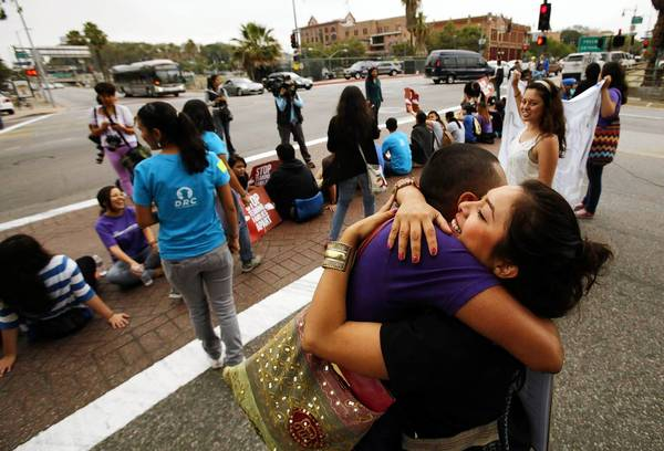 Nancy Guarneros, 25, right, hugs Jorge Gutierrez, 28, as they join more than 150 students and Dream Act supporters who rallied in downtown Los Angeles on Friday to voice support for President Obama's decision to halt the deportation of young illegal immigrants who have no criminal records and meet certain other criteria.