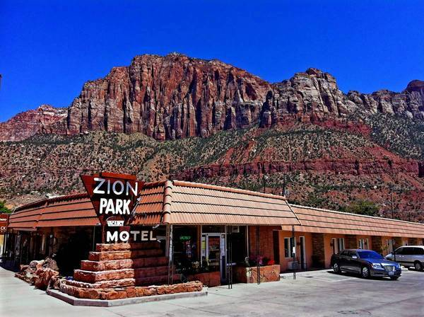 The Zion Park Motel in Springdale, Utah, has towering red sandstone cliffs as a backdrop. The motel was built in 1972.