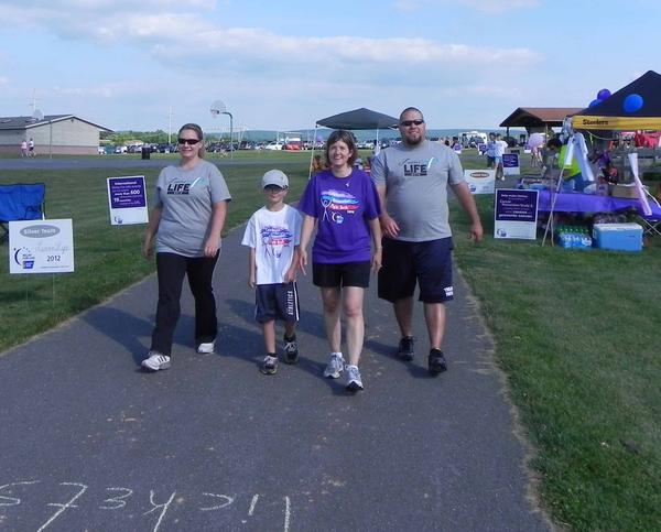 Members of Team Luvin' Life take a lap during the American Cancer Society's Relay for Life of Chambersburg at Norlo Park on Friday. Pictured left to right: Nichole Kunkle, Chambersburg, Pa., Vance Kunkle, 8, Chambersburg, Maegen Hess, Chambersburg, and Sam Hess, Chambersburg.