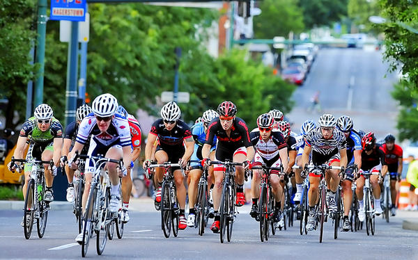Cyclists competing in the Kickoff Classic Criterium make their way along S. Potomac Street Friday evening.