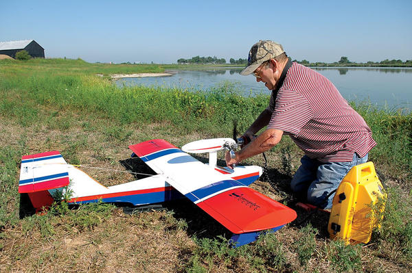 Burch Krebs works on a float plane at the Winchester Municipal Utilities Northeast Retention Basin.