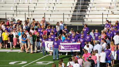 Cancer survivors and care givers took a lap around the Somerset high school track Friday evening for the 20th annual Somerset Relay For Life.