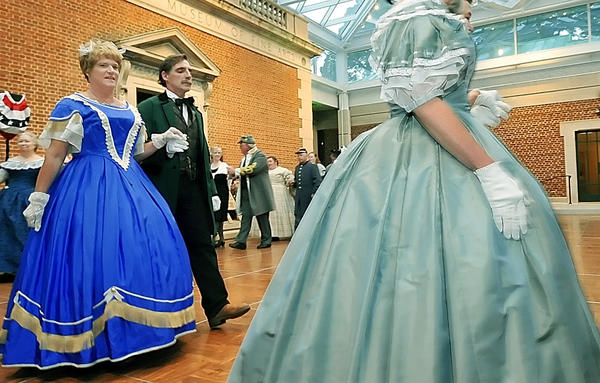 Nancy and Barry Groomes of Taneytown dance with others dressed in period clothing during a Civil War Ball held at the Washington Co. Museum of Fine Arts.