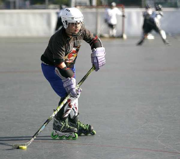 George Keshishian, 12 of Burbank, takes aim at the goal during free skate night at the Burbank Roller Hockey Court in Burbank.