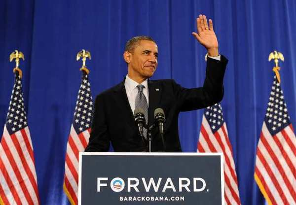 President Obama waves at supporters before speaking on the economy during a campaign event at the Cuyahoga Community College in Cleveland, Ohio.