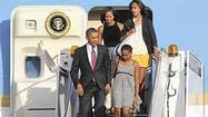 President Barack Obama and his family landed atO'Hare International Airport on Friday and were quickly whisked off to their South Side home aboard the Marine One helicopter.