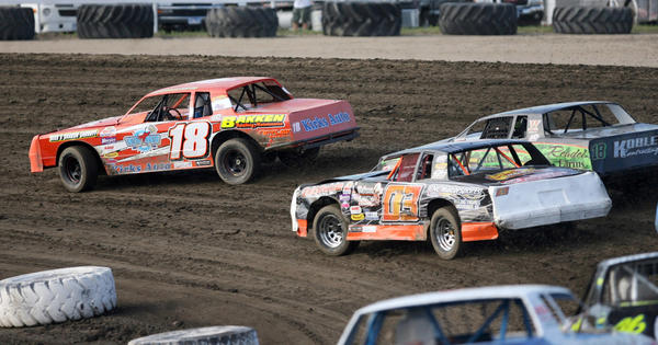 Jeromy Thorstenson, of Bath (18) leads Steven Grabow, of Milbank (03) and Joe Jacobson, of Jamestown (18J) during the first heat of street stock action Friday night at the Brown County Speedway. photo by john davis taken 6/15/2012