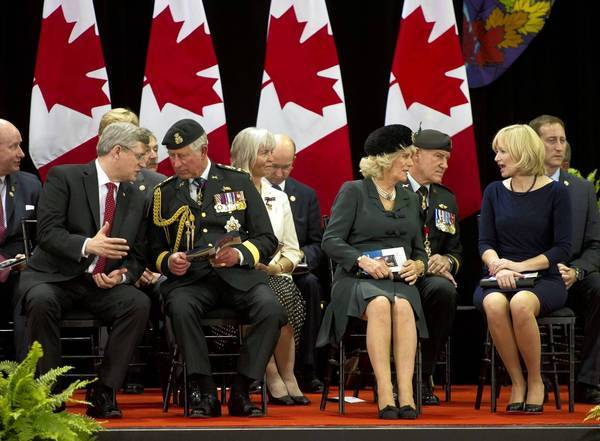 Canadian Prime Minister Stephen Harper, from left, speaks to Britain's Prince Charles, while the Duchess of Cornwall and Laureen Harper chat during the 1812 Commemorative Military Muster in Toronto last month.