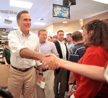 Mitt Romney talks to supporters in Wawa Gas Station on Route 309 on Saturday.
