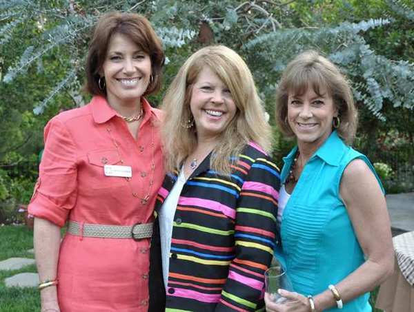 Pam MacDonald, from left, Sheree Butts and Mary Anne Lantieri, all members of Los Altos Auxiliary, enjoy the wine tasting party.