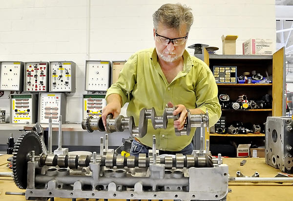 Richard Rice of Greencastle takes apart an airplane engine crankshaft to check the tolerances during class at Pittsburgh Institute of Aeronautics