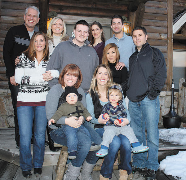Erik Bergman loved getting the whole family together for winter and summer vacations each year. This photo was taken at Deep Creek Lake in January. Seated, from left, are Tiffany Kenyon, holding son, Gage Kenyon; and Erin Bergman Sperco, holding son, Christian Sperco. Standing, from left, are Erik Bergman, Victoria Kenyon, Sheri Bergman, Bobby Kenyon, Amy Bergman, Joane and Mark Bergman, and Dan Sperco.