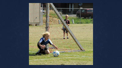 Goalie Brandon Tomory dives for the ball Saturday. He plays on a U8 soccer team.