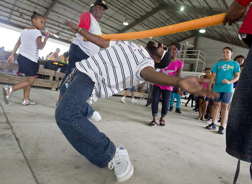 Telece Coleman does the limbo at the Juneteenth festival in Newport News on Saturday, June 16.