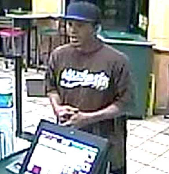 Glendale police are asking for the public to help them identify two gunman who robbed local stores. Above, a man robs a Subway on May 30.