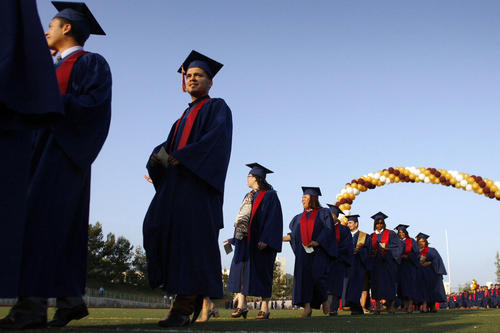 PCC's graduates march into the stadium during their 87th Annual Commencement, which took place at the Robinson Stadium in Pasadena on Friday, June 15, 2012.