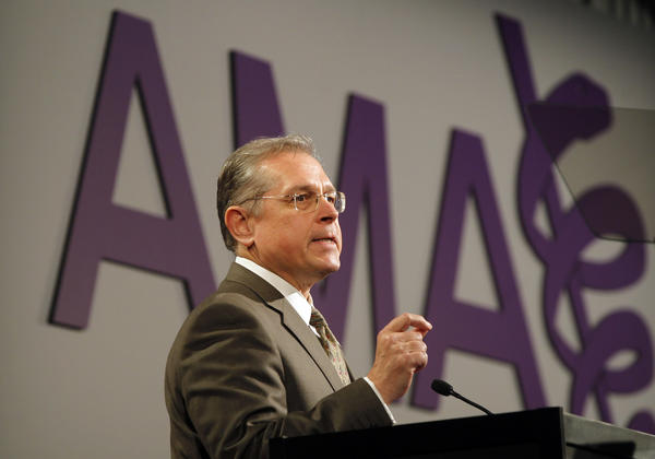 Dr. James Madara speaks at the American Medical Association meeting Saturday.