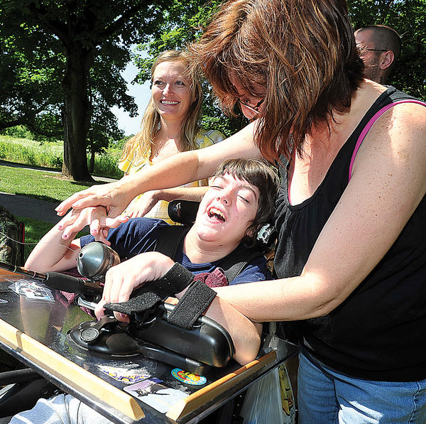Marianne Morningstar and her daughter Megan laugh while enjoying their first fishing experience Saturday at Pangborn Park lake. Hagerstown hosted the annual fishing derby for senior, disabled, and children. Family friend Tessia Wile joins in.