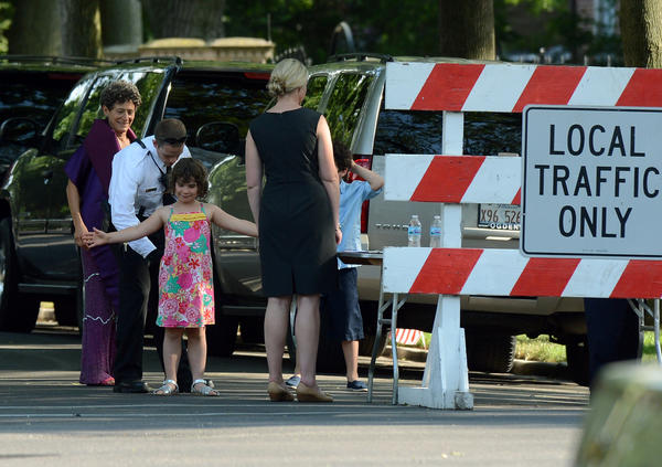 A member of the Secret Service scans a young girl guest arriving at Valerie Jarrett's house.