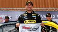 Marcos Ambrose sets restrictor-plate-era qualifying record at Michigan