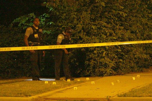 Chicago police investigate a multiple shooting at 99th Street and Paxton Avenue on June 16, 2012.