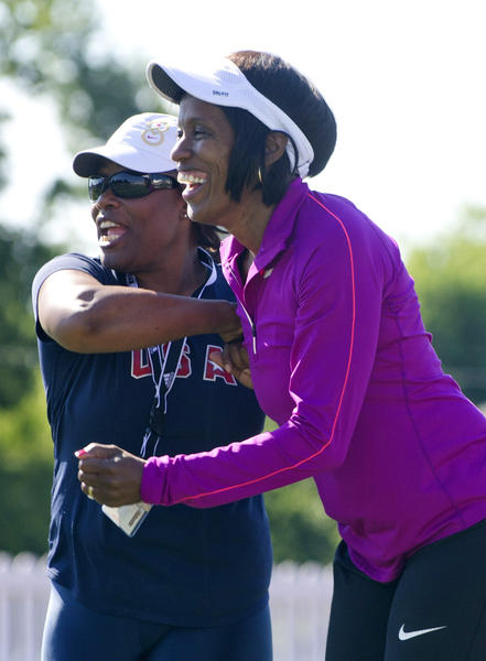 Sharrieffa Barksdale, left, laughs with Jackie Joyner-Kersee during the Maximum Velocity Track and Field Academy last week at Centre College.