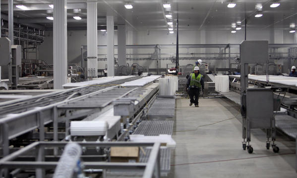 Work continued on April 17 in the packaging area at the Northern Beef Packers plant. American News Photo by John Davis
