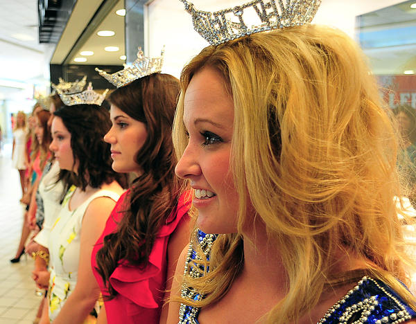 Miss Smithsburg Lindsay Karroll joins other tiara-clad contestants Sunday at the Miss Maryland pageant kickoff event at Valley Mall.