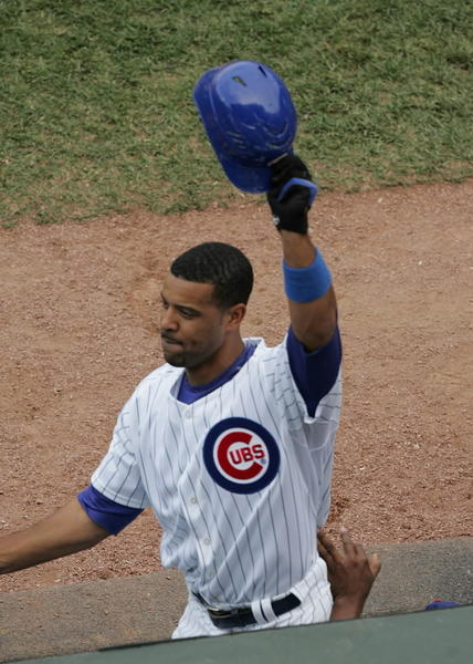 Derrek Lee tops off a Cubs win with a late grand slam at Wrigley Field.