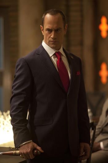 Christopher Meloni plays the powerful and well-dressed Roman.