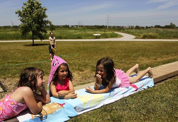 "Megan Fitzpatrick, 7, from left, Zophia Popadiuk, 6, and Zophia's twin sister, Donna, chat during the Buzz on Bugs day camp at James ""Pate"" Philip State Park in Bartlett, Ill. Some state parks are in danger of closing as the Illinois Department of Natural Resources grapples with a slashed budget and the failure of proposed new funding sources to gain traction."