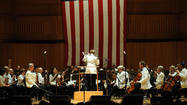 With a giant flag of 15 stars and stripes as a backdrop inside Meyerhoff Symphony Hall, a celebratory concert Sunday night drew a packed house to cap the weekend's commemoration of the War of 1812 bicentennial.
