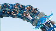 Some of the first official riders enjoy Manta on opening day at SeaWorld San Diego.
