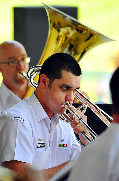 Trombone player Leading Seaman Daniel McMahon plays Sunday in a concert at the Alumni Amphitheater at Hagerstown Community College. McMahon and fellow musicians of the Royal Australian Navy Band played the concert with the Maryland Defense Force Band. The concert was co-sponsored by the HCC Alumni Association and the Hagerstown-Washington County Convention and Visitors Bureau.