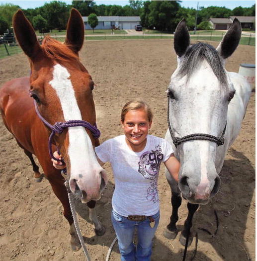 Allie Simons of Aberdeen with her rodeo horses Dually (left) and Skippy. Simons said she is thankful to have the opportunity to rodeo. American News Photo by John Davis