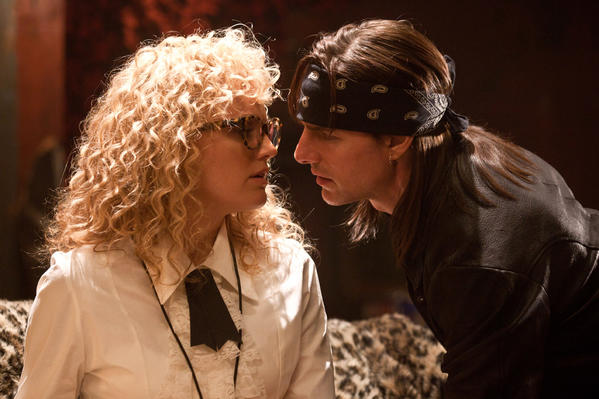 caption: This film image released by Warner Bros. Pictures shows Malin Akerman as reporter Constance Sack, left, and Tom Cruise as rock star Stacee Jaxx in New Line Cinemas rock musical, Rock of Ages, which opened Friday, June 15.