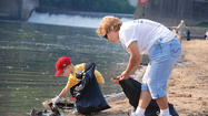 Mother, son clean up river