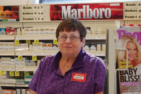 Donna Lane, manager at CVS, greets customers by name and lends an encouraging word.