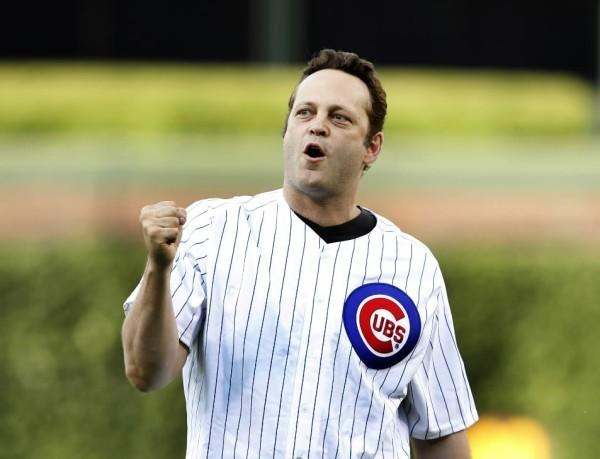 Actor Vince Vaughn celebrates his first pitch before the Cubs-Boston Red Sox game at Wrigley Field June 16, 2012.