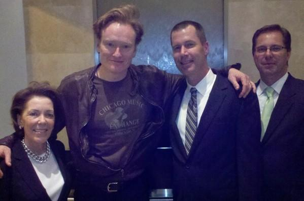 """Conan"" host Conan O'Brien (second to left) poses with staff at N9NE Steakhouse during his talk show's Chicago wrap party June 14, 2012."