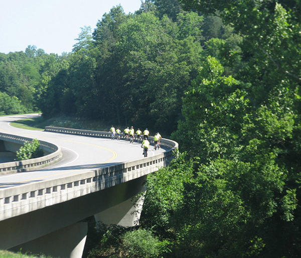 Members of Forkland Boy Scouts of America Troop 71 cross a bridge on the Natchez Trace Parkway near Franklin, Tenn., as part of their nine-day bicycle trek.