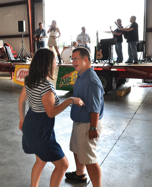 Ginny Taber, left, dances with STRIDE participant Justin Rose at the annual STRIDE concert and auction at Ron and Judy Tierney's warehouse on Rockwell Road.