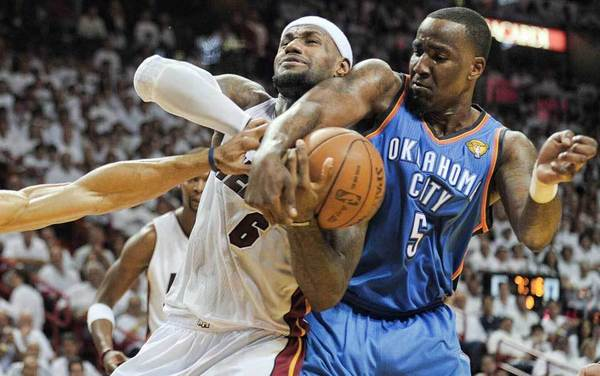 Miami Heat forward LeBron James is fouled by Oklahoma City Thunder center Kendrick Perkins during the second quarter of Game 3 of the NBA Finals, Sunday, June 17, 2012 at AmericanAirlines Arena.