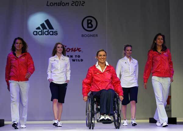 German hockey players Christina Schuetze (L) Janne  Mueller Wieland (R) and Paralympics swimmer Kirsten Bruhn present the official uniforms of the German Olympic team for the 2012 Olympic Games in Duesseldorf April 24, 2012.