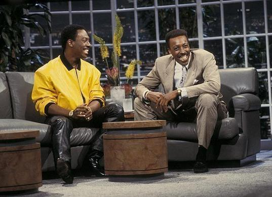 """Coming to America"" costars Eddie Murphy and Arsenio Hall pal around on the set of the syndicated ""The Arsenio Hall Show"" (1989-1994)."