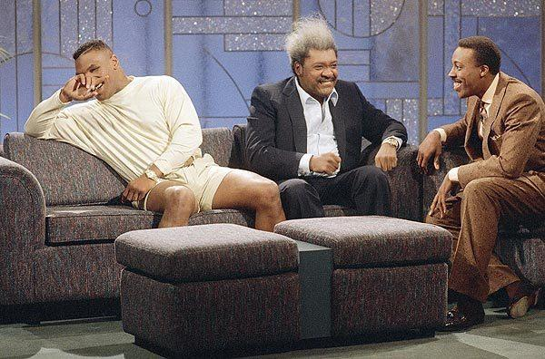Arsenio Hall's best television moments: Heavyweight boxing champion Mike Tyson (with promoter Don King) cracks up during a Feb. 28, 1989, visit to The Arsenio Hall Show after the host mimicked a flurry of punches Tyson had used in his title defense against Frank Bruno.