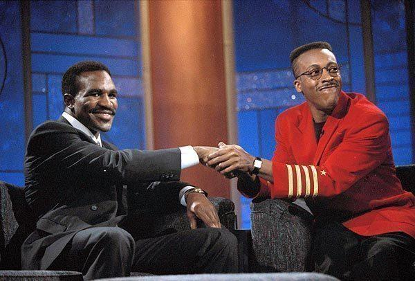 Arsenio Hall's best television moments: Heavyweight boxer Evander Real Deal Holyfield, left, shakes hands with talk show host Arsenio Hall during the taping of Halls late-night show, Oct. 26, 1990, in Los Angeles.