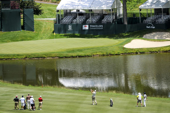 Daniel Miernicki hits the ball onto the 17th green at TPC River Highlands in Cromwell during the Aetna Pro-Am on Monday afternoon.