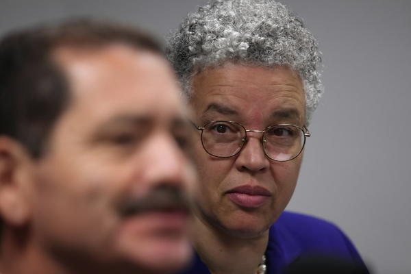 "Cook County Board President Toni Preckwinkle, right, listens as Commissioner Jesus ""Chuy"" Garcia talks at a news conference Monday."